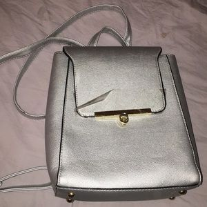 Cute grey purse fits with any outfits
